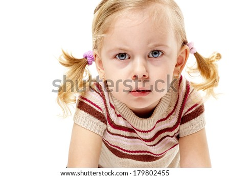 Furious adorable little girl frowning and leaning forward in anger - stock photo