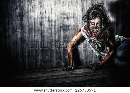Furious bloody zombie girl. Horror. Halloween.  - stock photo