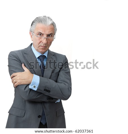 Furious boss crossing arms. - stock photo