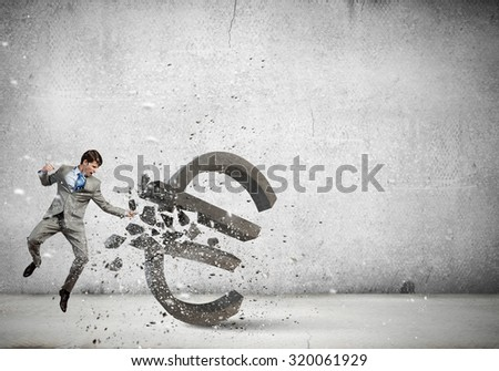Furious businessman crashing with fist euro sign