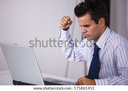 Furious businessman ready to smash his laptop - stock photo