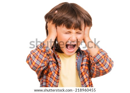 Furious little boy. Frustrated little Boy shouting and holding head in hands while standing isolated on white - stock photo