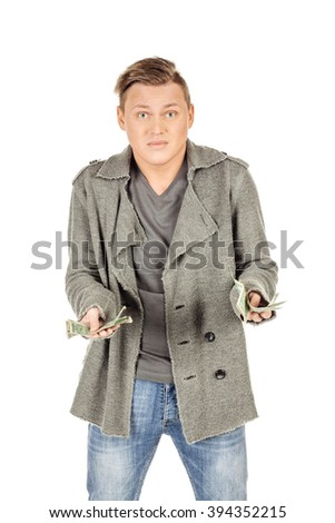 Furious man anger holding money on white background - stock photo