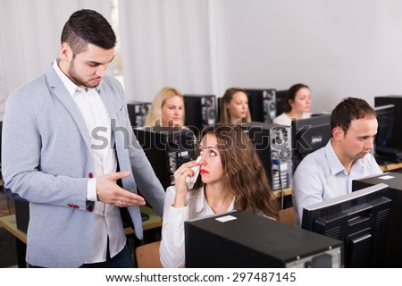 Furious manager scolding unhappy office worker - stock photo