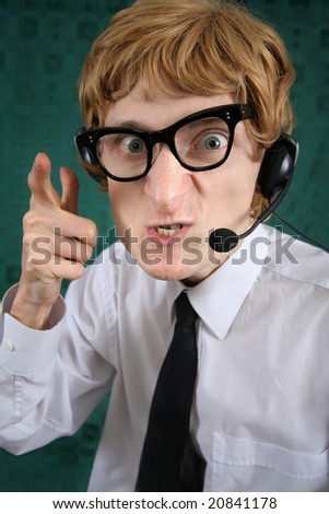 Furious nerdy phone operator - stock photo