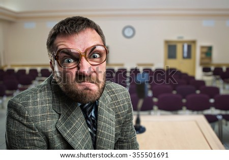 Furious speaker in glasses at hall - stock photo