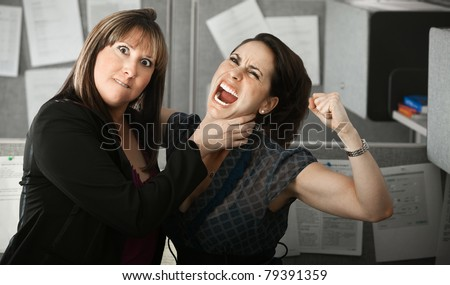Furious woman office worker chokes coworker's neck