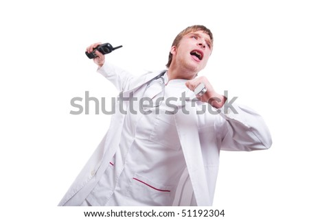 Furious young doctor throwing phone against white background.