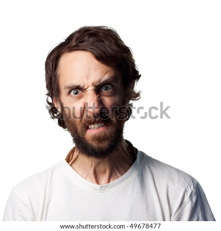 Furious young man screams at camera - stock photo