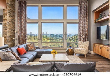 Furnished living room in upscale new home - stock photo