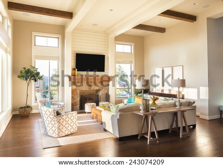 Furnished living Room Interior with Hardwood Floors and Intricately Designed Ceiling in Beautiful New Luxury Home - stock photo