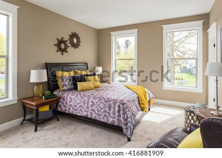 Furnished master bedroom interior in new home with colorful furnishings. Home Furnishings Stock Images  Royalty Free Images   Vectors