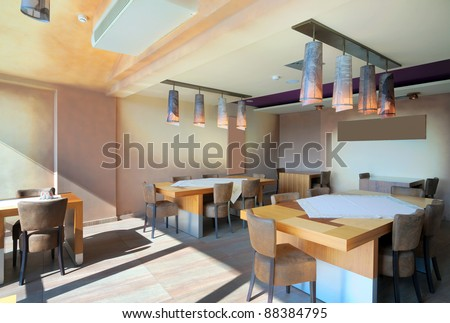 Furniture and decoration of a restaurant, modern style, day time.