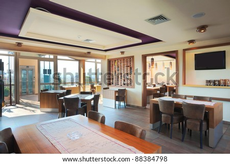 Furniture and decoration of a restaurant, modern style, day time. - stock photo
