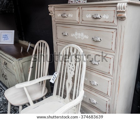 "Furniture for sale at a flea market ""shabby chic"" style."