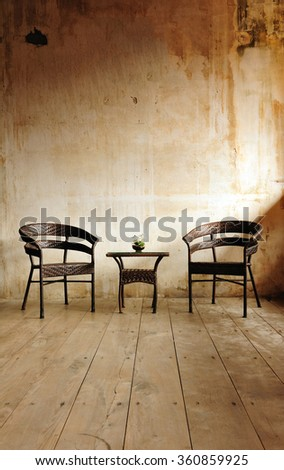 Furniture in vintage wood room - stock photo