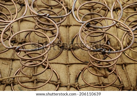 furniture springs inside the old chair, horizontal - stock photo
