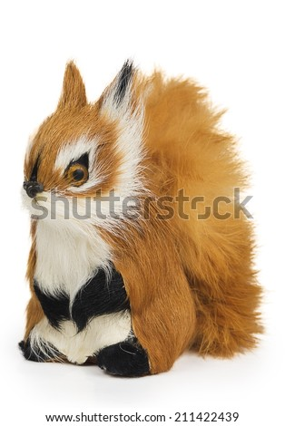 Furry squirrel toy isolated on white background - stock photo