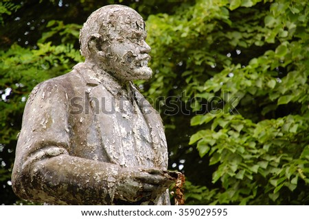 FURSTENBERG, GERMANY -JULY 21, 2008: Shabby and flaky Lenin statue in front of the former Soviet army headquarters after withdrawal of Soviet troops. - stock photo