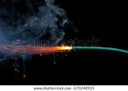 Fuse burning on black background isolated