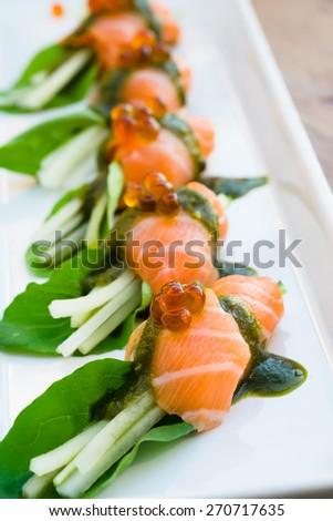 Fushion sushi sashimi with gren vegetable on white plate - stock photo