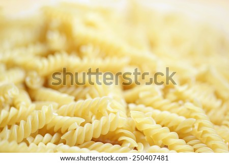 Fusilli - backgrounds with pasta twists, selective focus - stock photo