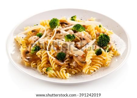 Fusilli pasta with champignons and sauce  - stock photo