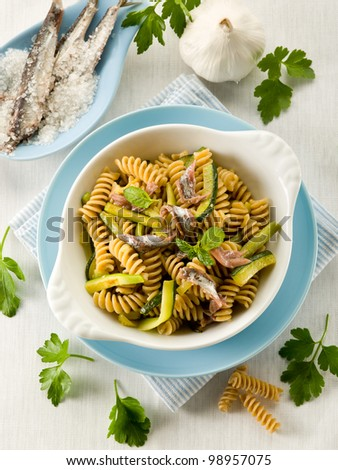 fusilli with anchovies and zucchinis - stock photo
