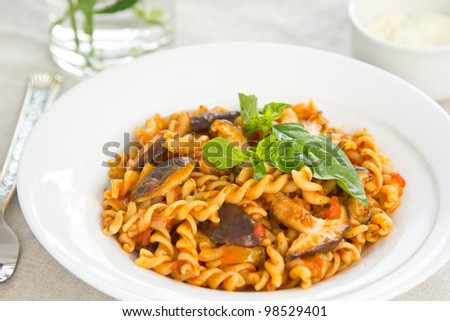 Fusilli with mushroom in tomato sauce