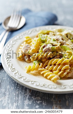 Fusilli with mushrooms, leek and mascarpone sauce   - stock photo