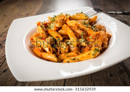 Fusion cuisine. Pasta with meat sauce and greek white giant beans. - stock photo