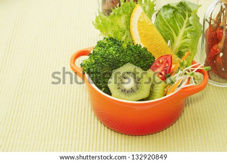 fusion food, fruit and vegetable salad in colorful cup