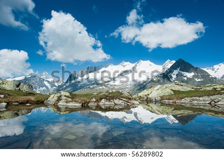 Fusshorn (3627m) and Geisshorn(3640m) with small lake. View from  Bettmerhorn. Part of the Jungfrau-Aletsch UNESCO World Heritage, Wallis, Switzerland - stock photo