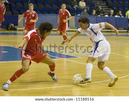 Futsal offense - stock photo