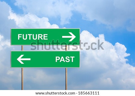 future and past on green road sign with blue sky - stock photo
