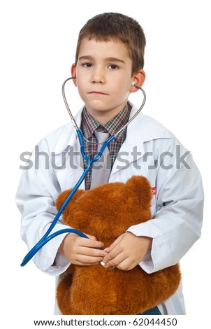Future doctor boy examine his teddy bear with stethoscope isolated on white background - stock photo