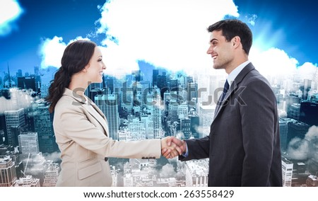 Future partners shaking hands against high angle view of city - stock photo