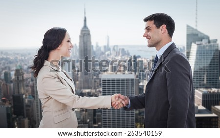 Future partners shaking hands against new york - stock photo