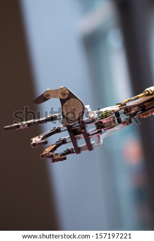 Future technology in black prosthetic hand with a blurred backgound - stock photo