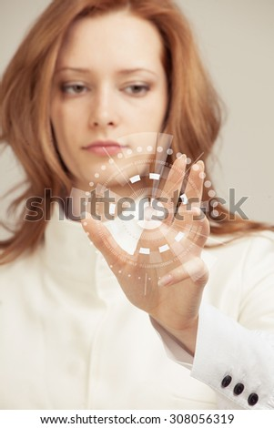 Future technology. Touch button interface. Woman working with futuristic interface  - stock photo