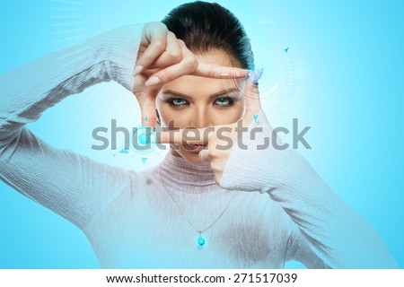Future technology Virtual Holographic interface. Hi-tech Girl touching screen. Business Young lady working with virtual Graphics in futuristic office. - stock photo