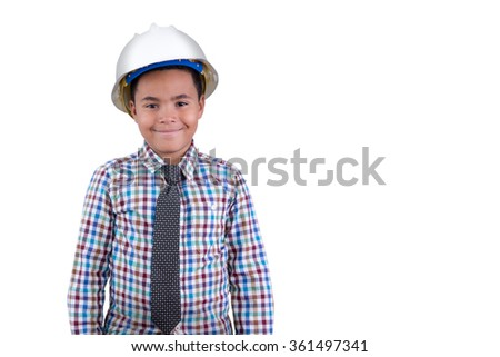 Future young African American engineer with a portrait of a charismatic young tween boy in a hardhat and necktie standing grinning happily at the camera as he shows his preference of career, on white - stock photo