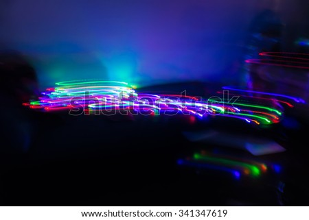 futuristic abstract glowing background resembling motion blurred neon light curves, abstract background