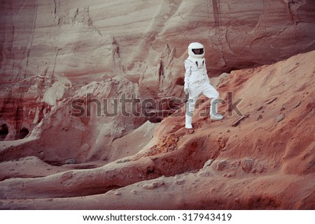 futuristic astronaut on another planet, image with the effect of toning - stock photo