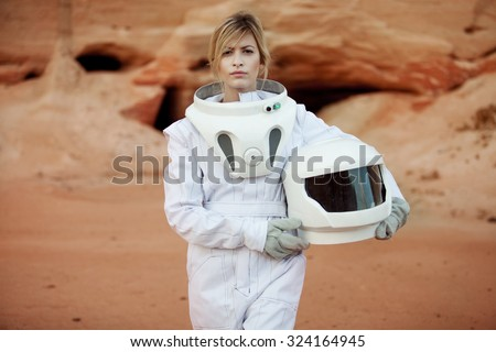 futuristic astronaut without a helmet on another planet, image with the effect of toning - stock photo