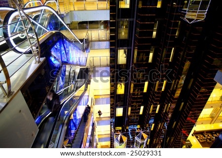 Futuristic black hall in mall with escalators and lifts - stock photo
