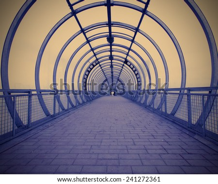 futuristic blue glass corridor with geometric perspective, instagram image style - stock photo