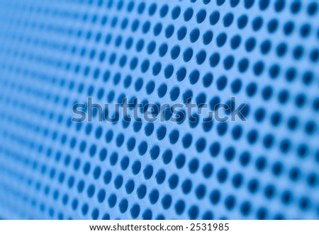 Futuristic blue hole grid making an abstract pattern. Shallow DOF. - stock photo
