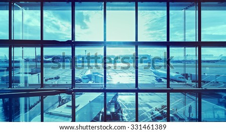 Futuristic blue picture of an airport, transportation and business travel concept. - stock photo