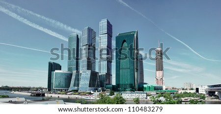 Futuristic buildings in Moscow City. Front view to high modern skyscrapers. - stock photo